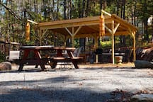 Picnic area, with grill and fire pit, at the top of the hill