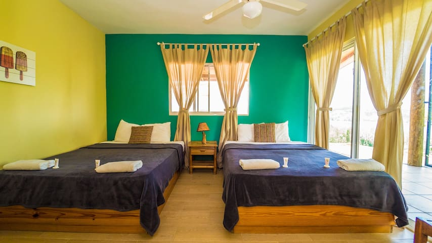 The Spacious Family Suite comes with Two Double Beds an Ensuite Private Bathroom, Fan, Fast WIFI, Closet, Private terrace with Seating Area and Beautiful Views.