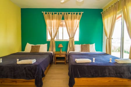 The Master Bedroom comes with Two Double Beds an Ensuite Private Bathroom, Fan, Fast WIFI, Closet, Private terrace with Seating Area and Beautiful Views.