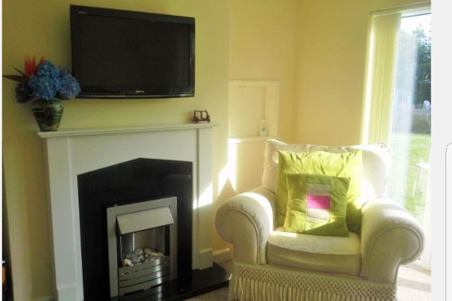 Our living room is light and airy with double doors out onto the garden