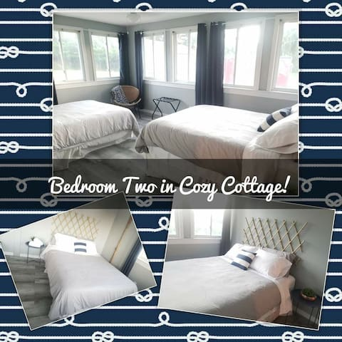 The second bedroom in Cozy Cottage has two high-end, comfortable, memory foam queen size beds.