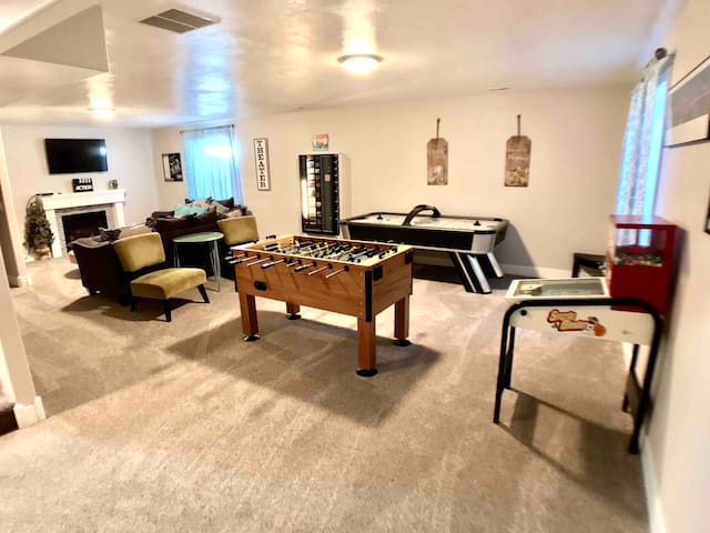 """Play away in our game room with fooseball table, air hockey table, vending machine, or relax and watch a game on the 55"""" smart TV"""