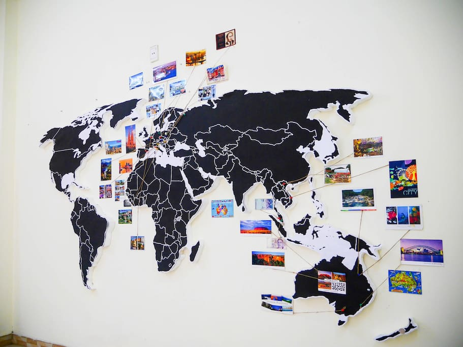 the postcards are from my travel. feel free to add your postcards on the wall and string point to its location on the map:)