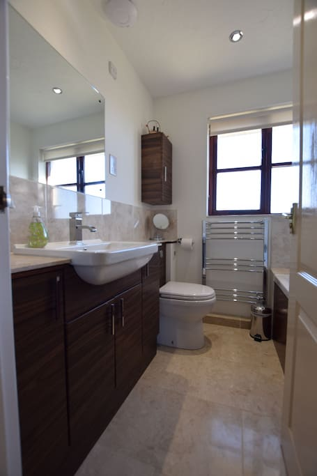 Family bathroom with underfloor heating.