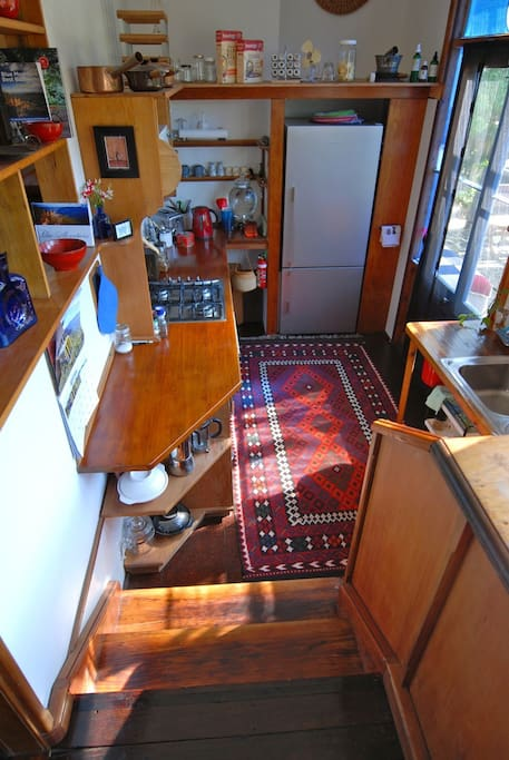 Well stocked kitchen, 2 steps down from living area to outside patio