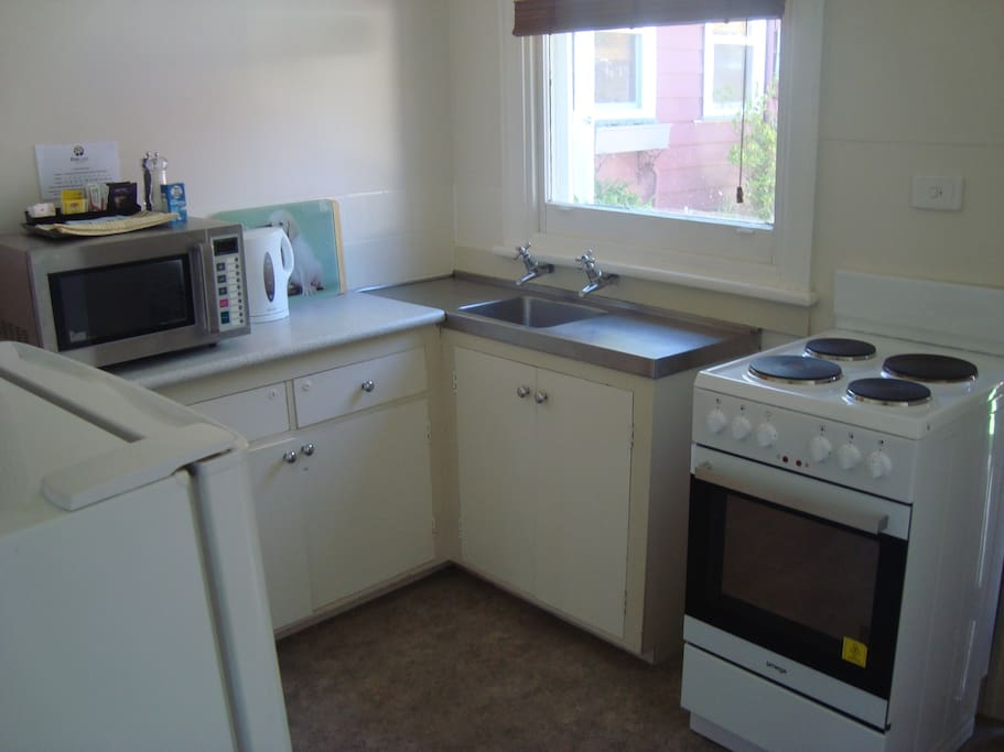 Full kitchen, stove, full size fridge, an electric fry pan, electric sandwich maker, toaster, kettle, microwave, plus all cutlery and crockery.