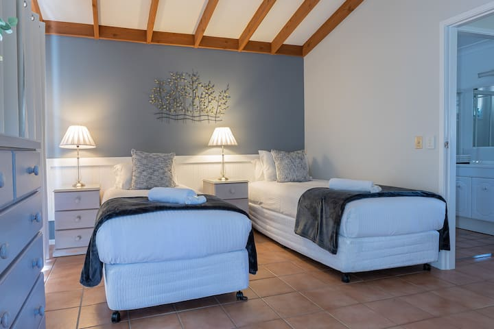 Hermitage Hideaway Cottage- King bedroom with bed split into long singles. Ask for this option prior to your stay.