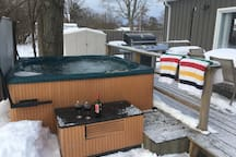 Directly off the back deck is a six person seasonal hot tub available fall, winter and spring only.