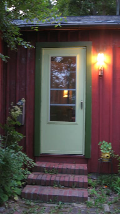 Guest entrance, across a small brick patio from the driveway with plentiful parking.
