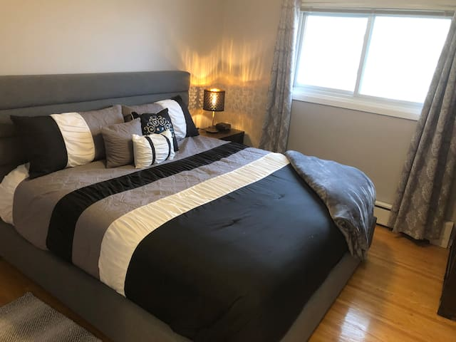 Bedroom 2 complete with King bed, large window night tables and alarm clock with rear USB ports for your electronic devices