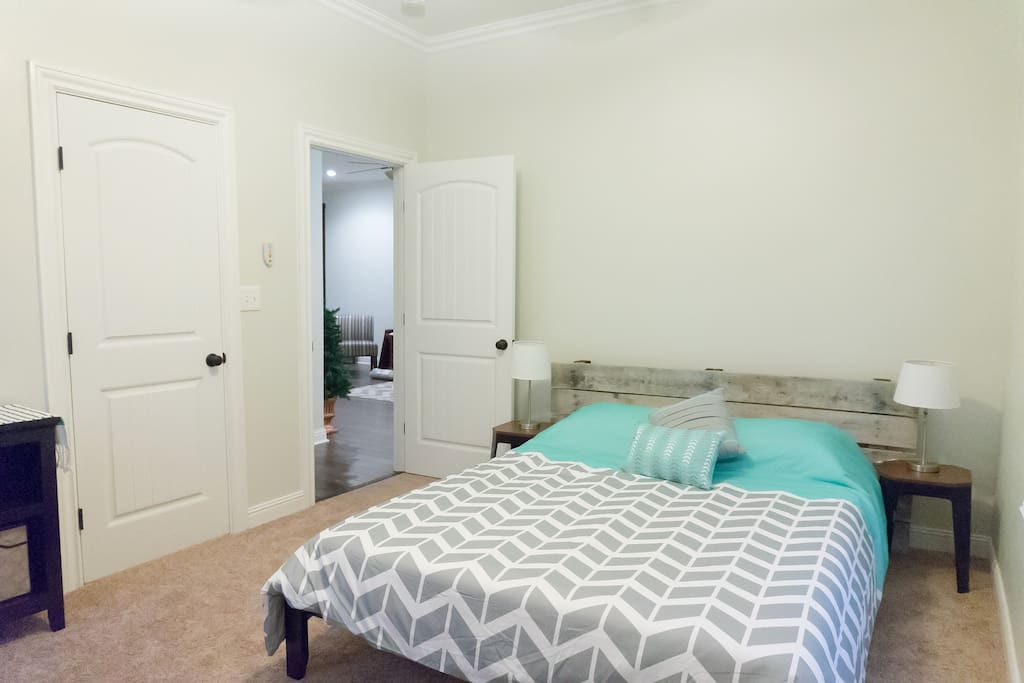 Private bedroom with memory foam queen bed, work desk, closet and modern dresser.