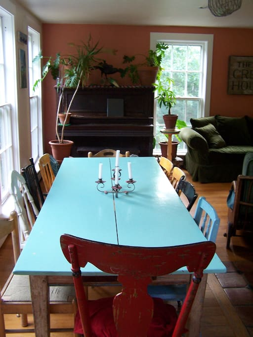 Kitchen table and piano.
