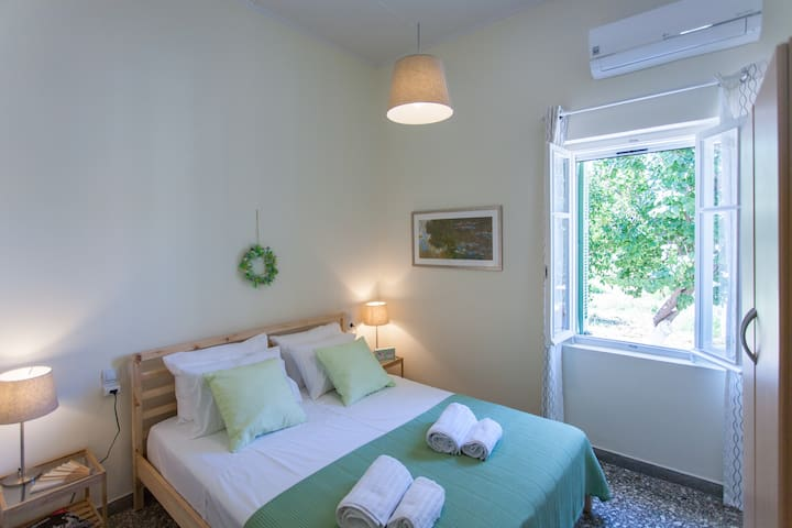 The modern bedroom with a comfortable, high quality and long king matress, has view in north-eastern side of  the garden!