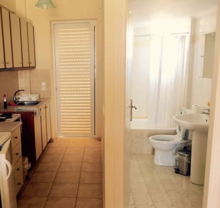 A view of the kitchenette and the private bathroom.