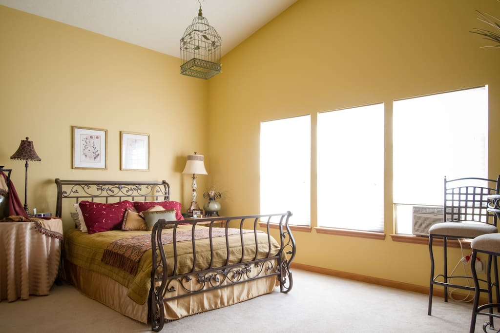 Sun-drenched, cathedral ceilings in the Master Bedroom. No worries though...if you like to sleep in, blindfolds are available!