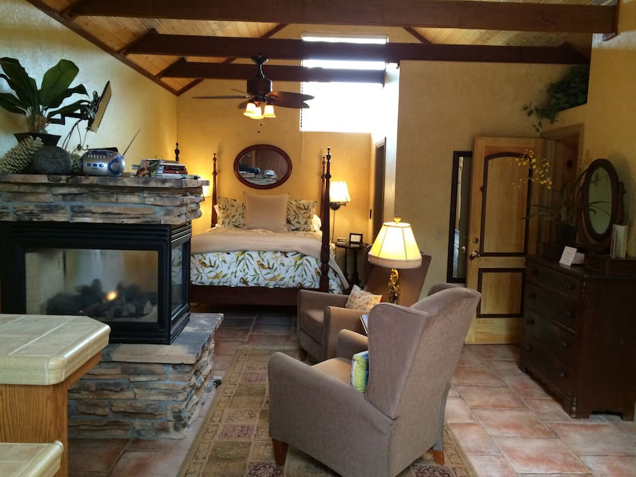 As you walk in facing master bed and fireplace, main sitting area