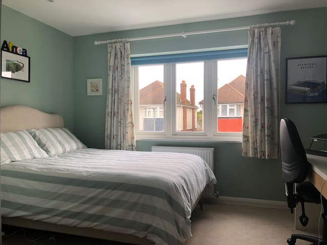 Bedroom 3. Double bed and desk, opposite family bathroom.