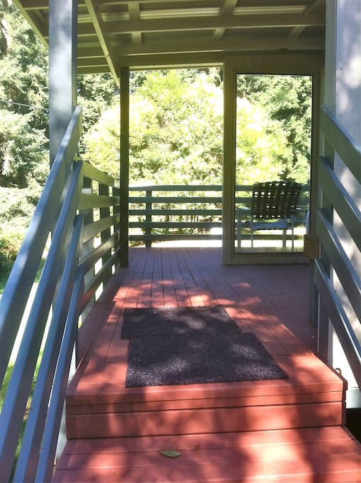 Four stairs up to covered private deck