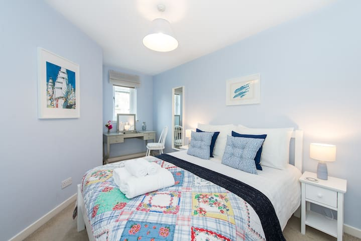 Relax on a comfy double sized bed after a long day out. Two pillows per guest are provided as standard
