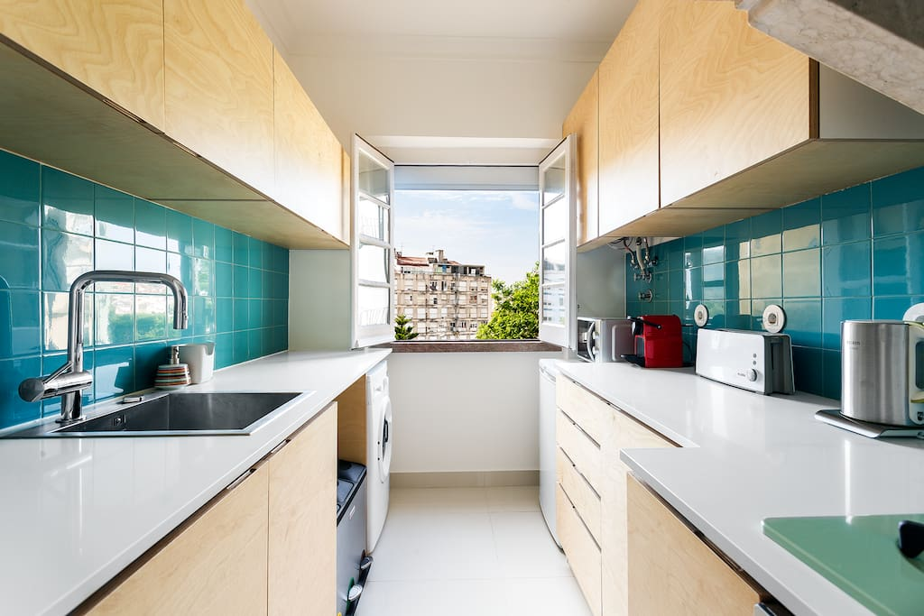 Fully equipped kitchen with views to the neighborhood.