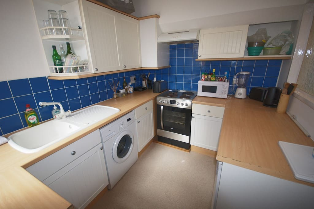 Fully equipped kitchen with new oven (one pictured has since been upgraded for new), microwave, toaster, kettle, fridge freezer etc.