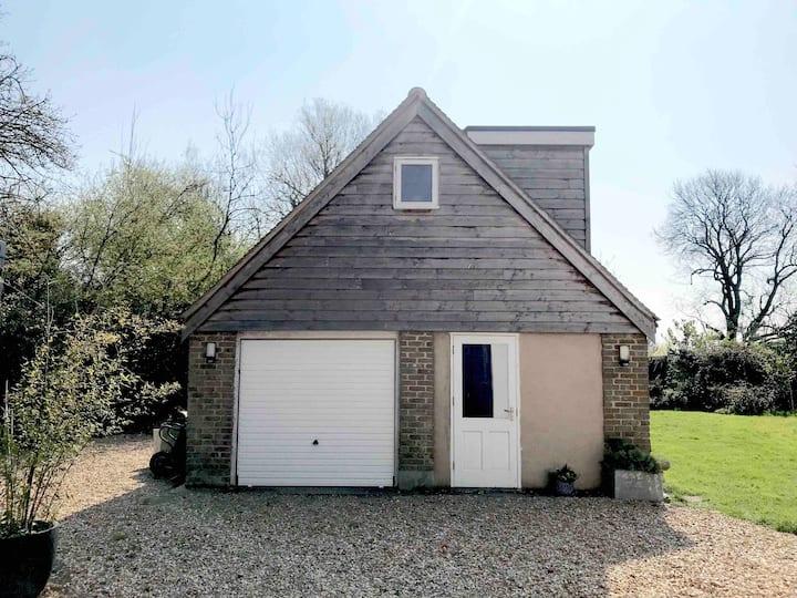 Charming bijou barn in pretty Sussex village
