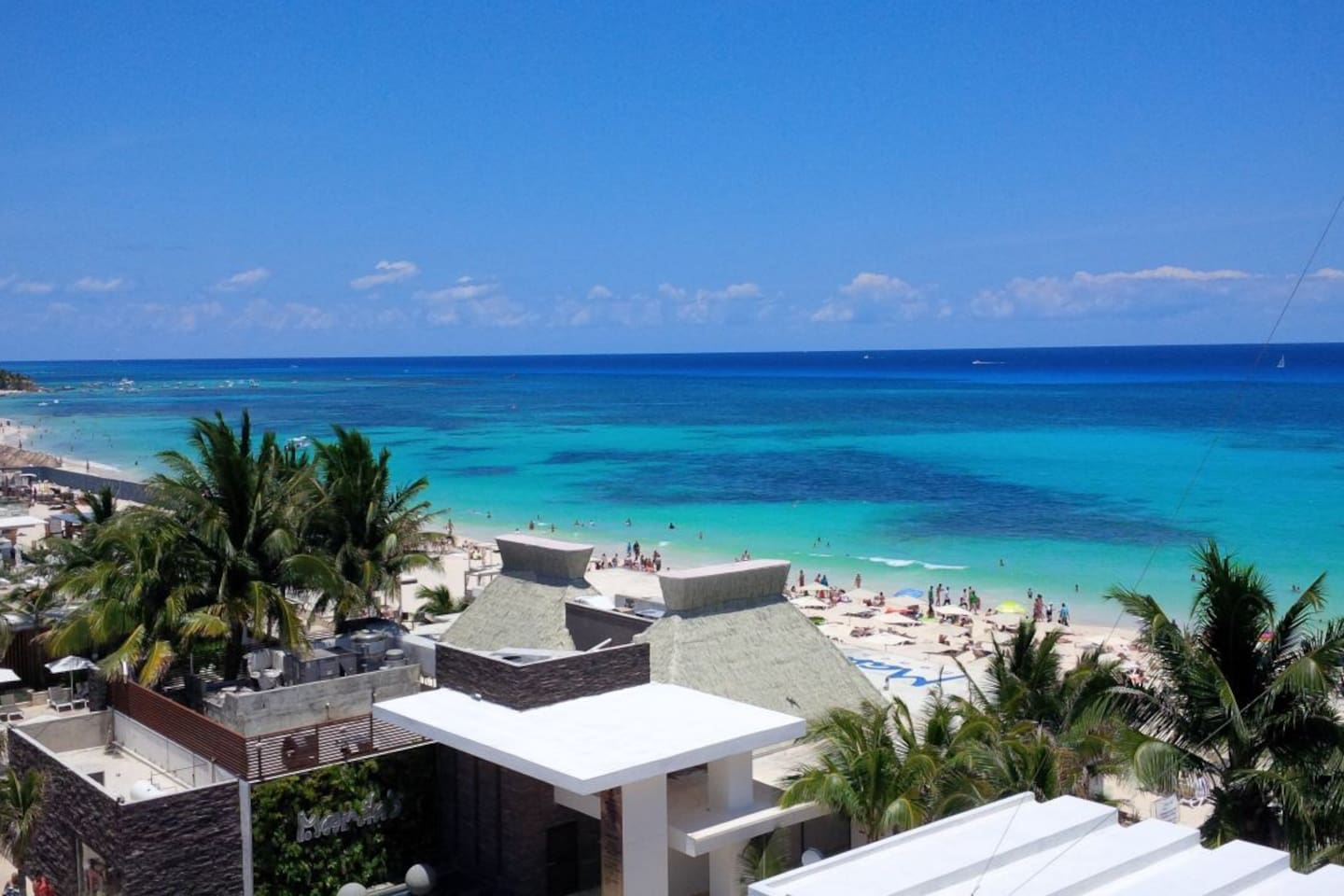 Beautiful look of the Amazing and Breathtaking Mamitas Beach in Playa Del Carmen from an Aerial view above the condo's balcony.