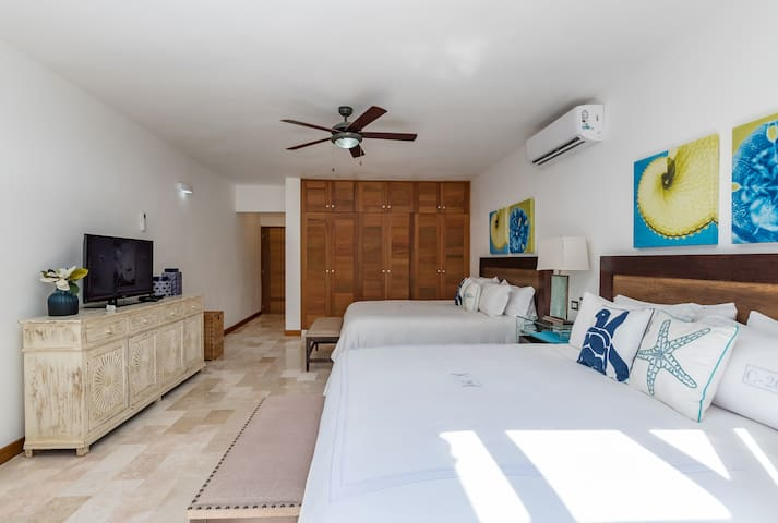 Spacious and airy bedroom with a giant bed & fresh linens for your sweet dreams