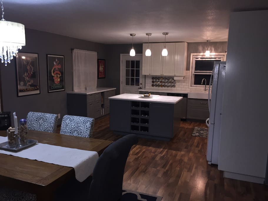 Fully stocked gourmet kitchen and dining area on the upper/main level
