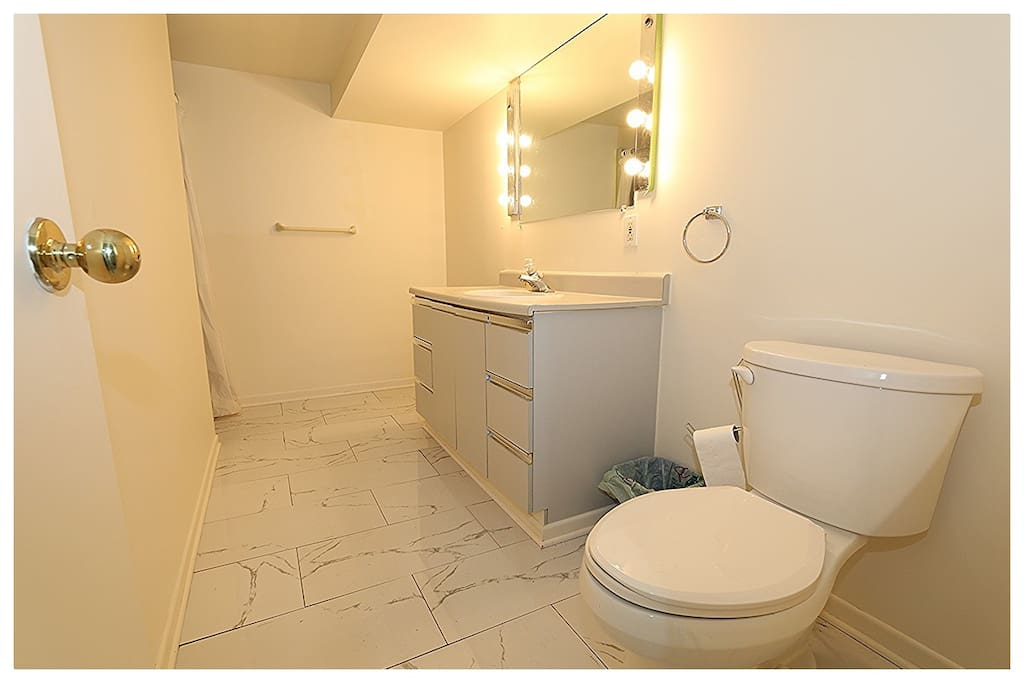 Newly renovated bathroom with marble floor.