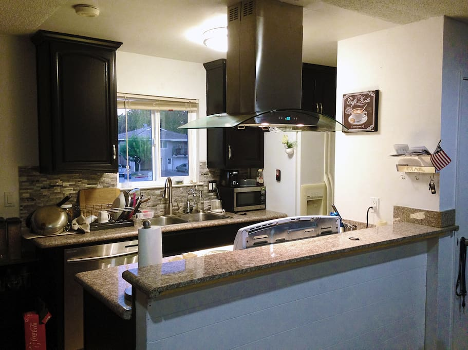 Remodeled Kitchen with new exhaust and stone tilework
