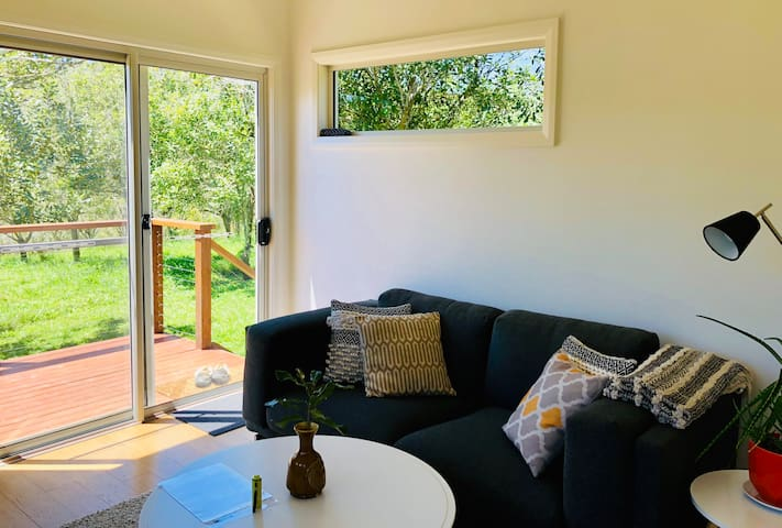 Lounge room with view on our macadamia orchard