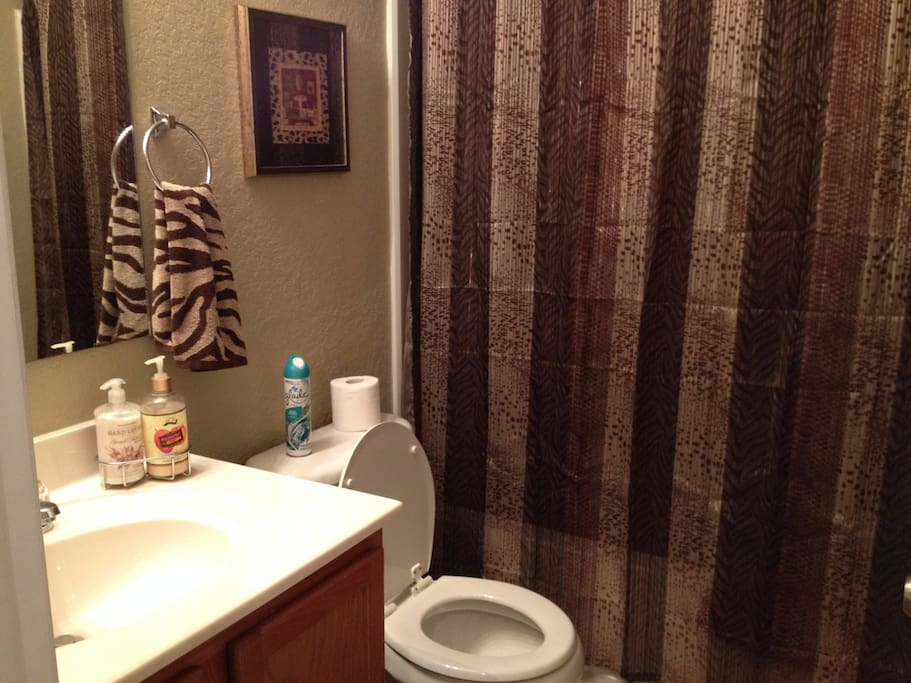 Private Guest Bathroom with fresh towels and basic toiletries.