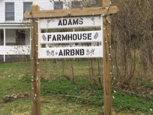 Adams Farmhouse is clearly marked with sign hand made by Marcel