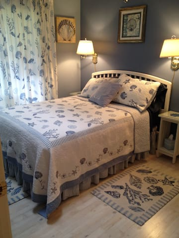 The bedroom is cozy and private and features a Queen size bed.  Please BRING YOUR OWN Queen sheets, blankets & pillows.