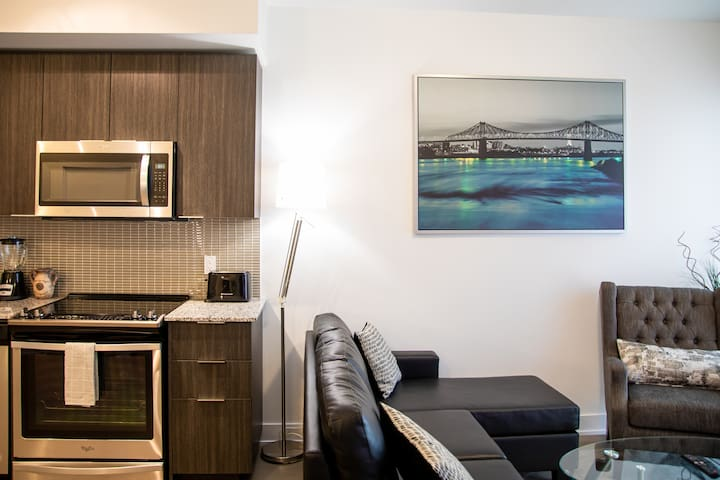 Brand New Lush Waterfront condo with FREE PARKING.