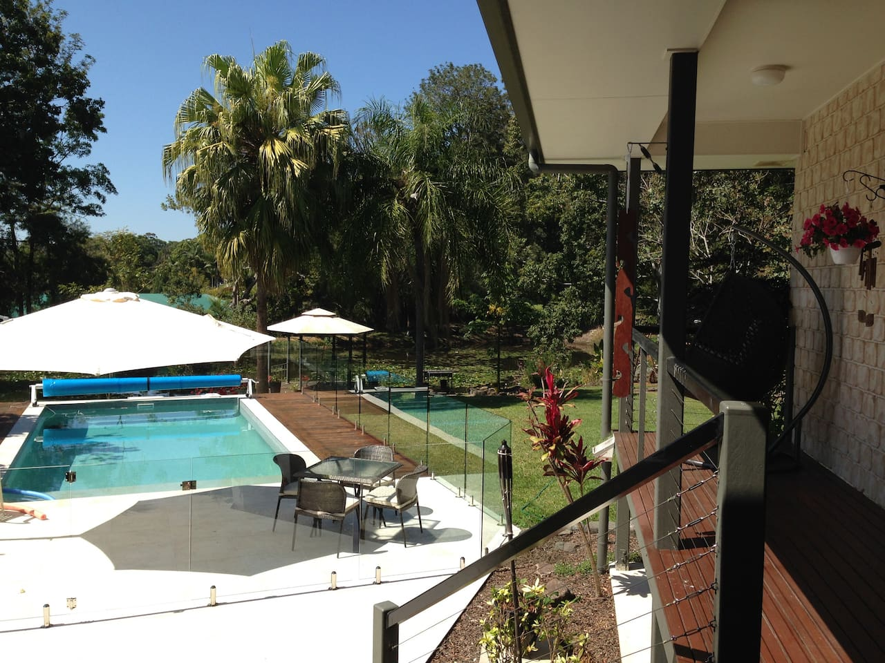 View from deck over pool, lawn and dam.