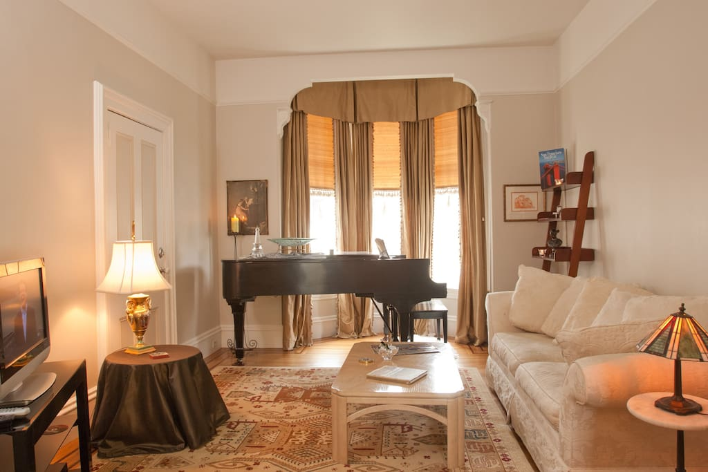1925B Steinway Baby Grand Piano in Bay Window.  Crown molding.