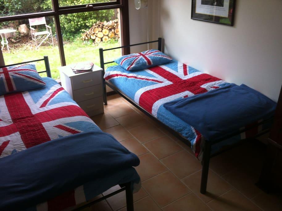 Bright double bedroom looking onto garden