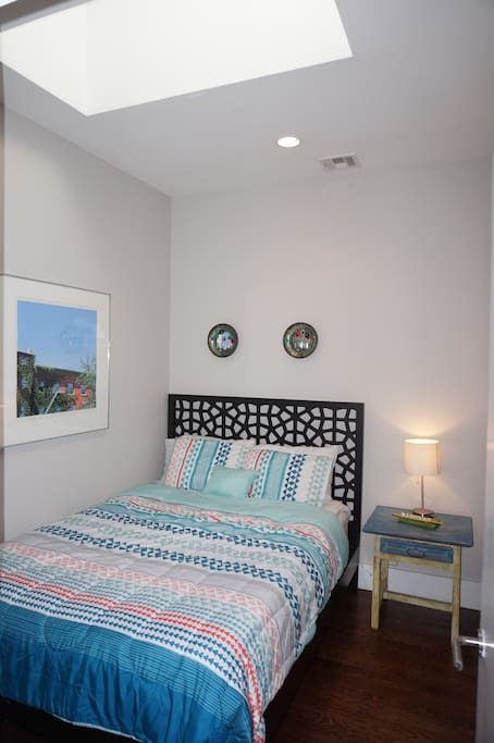 Your bedroom! Private and quiet with skylight and cozy queen bed.