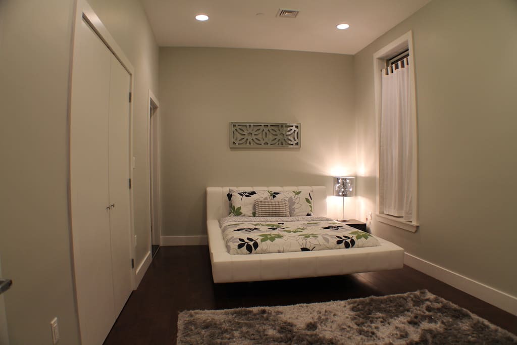 Master bedroom furnished with Lazzoni Queen size platform bed. The master bedroom has an ensuite bathroom