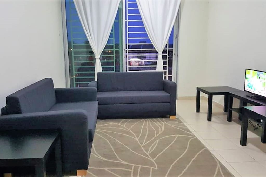 The living room is furnished with two sofa-beds