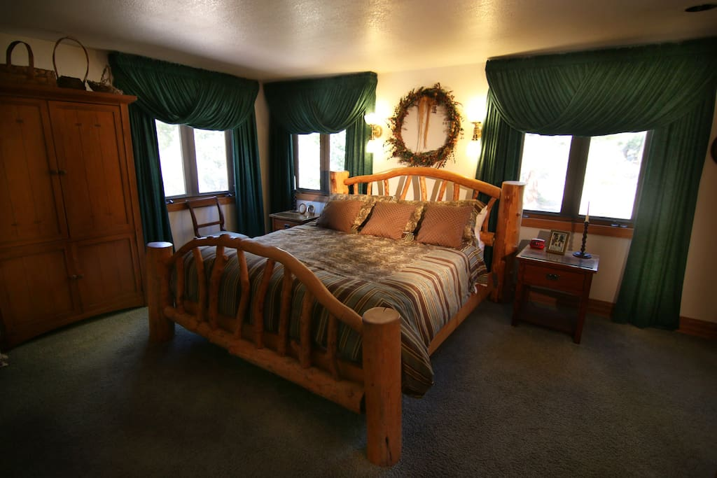 Master suite with king pillow top bed.