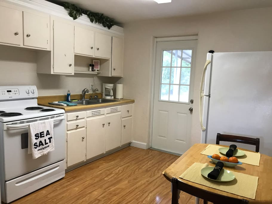 The kitchen featured a breakfast table with 4 chairs, full size stove and over, refrigerator, microwave, coffee pot, and much more.
