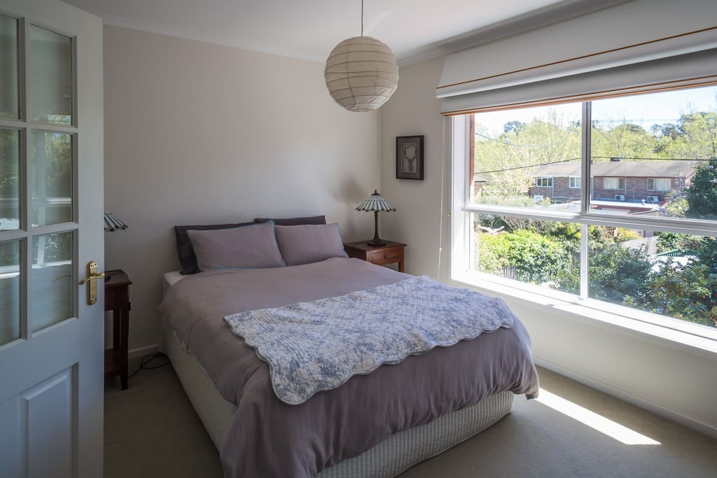 The bedroom, queen size bed, sunny outlook to garden.