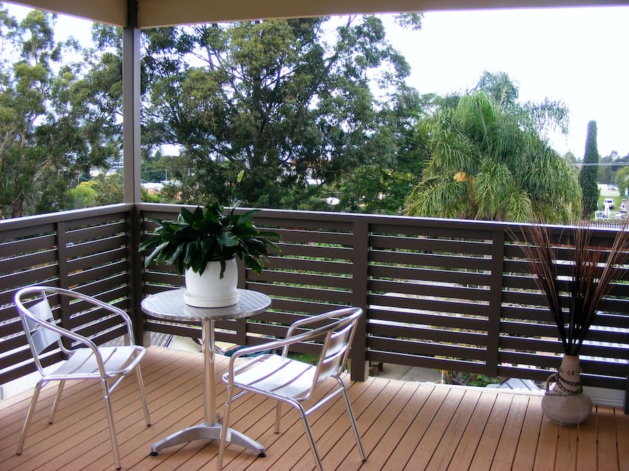 Upstairs private deck, with views of the bay.
