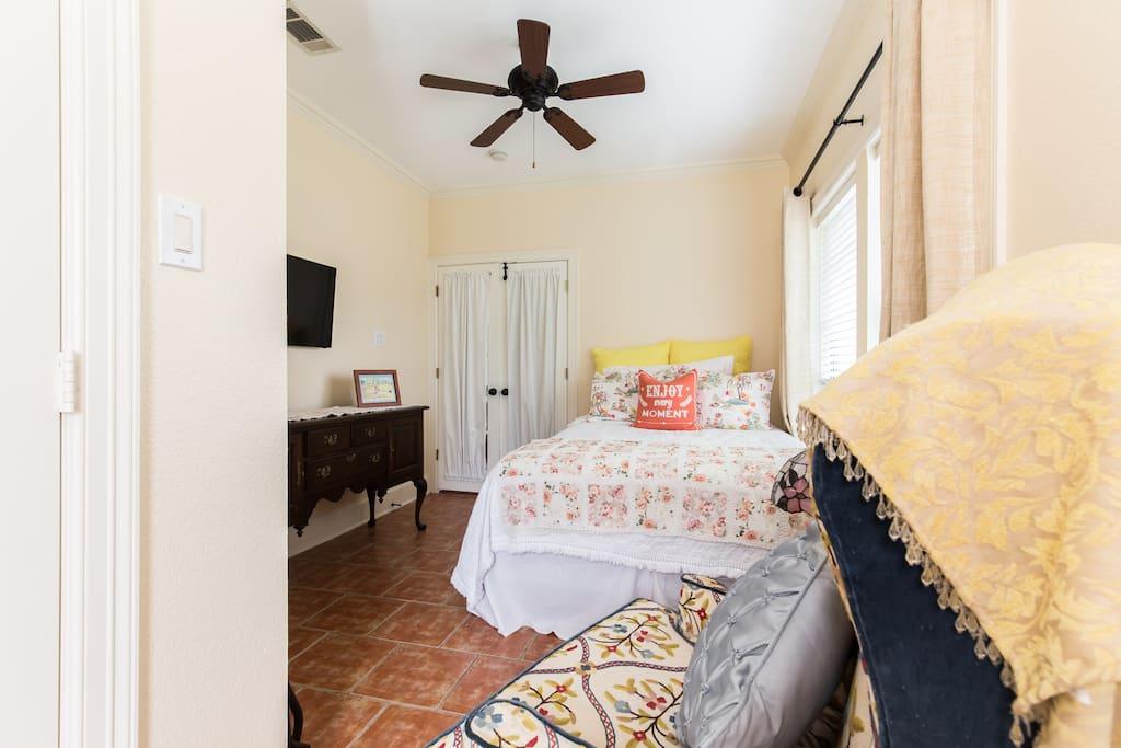Queen pillow top mattress, New Light fresh room color, Saltillo tile floor and ceiling fan