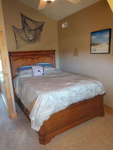 Second upstairs bedroom with a queen bed.