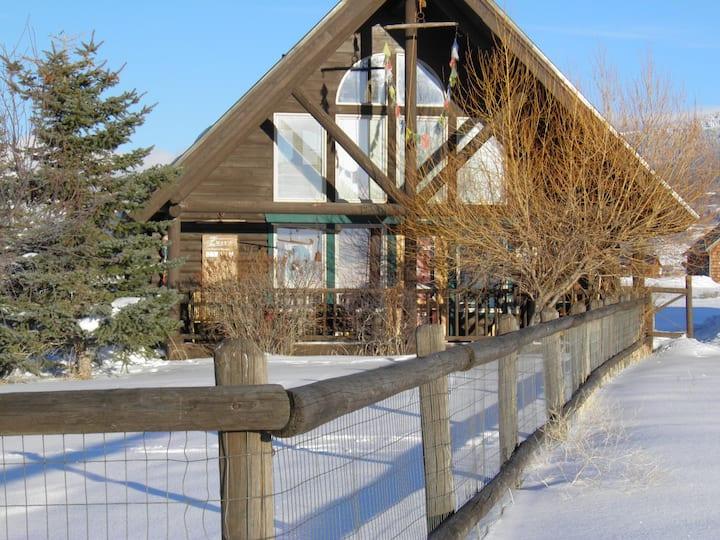 Sun and Snow-Kissed Teton Log Home