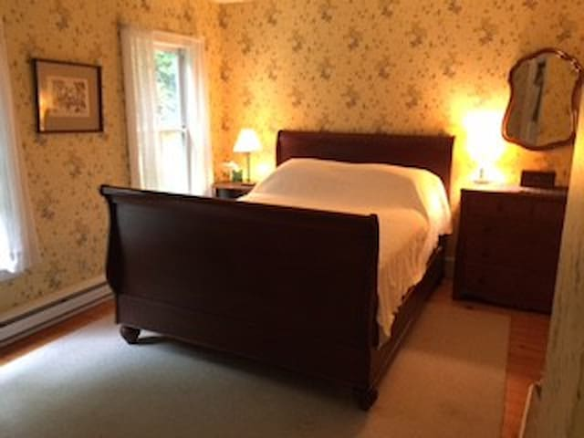 North facing bedroom has a queen and a twin bed. Bedroom #4 faces the woods.